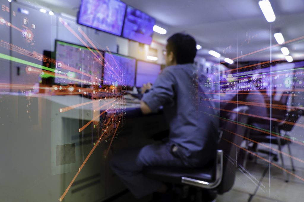 Double exposure Blurred light of man Engineering operations checking production process, Control room of a steam Turbine, Generators in the coal-fired power plant. Technology and industry concept
