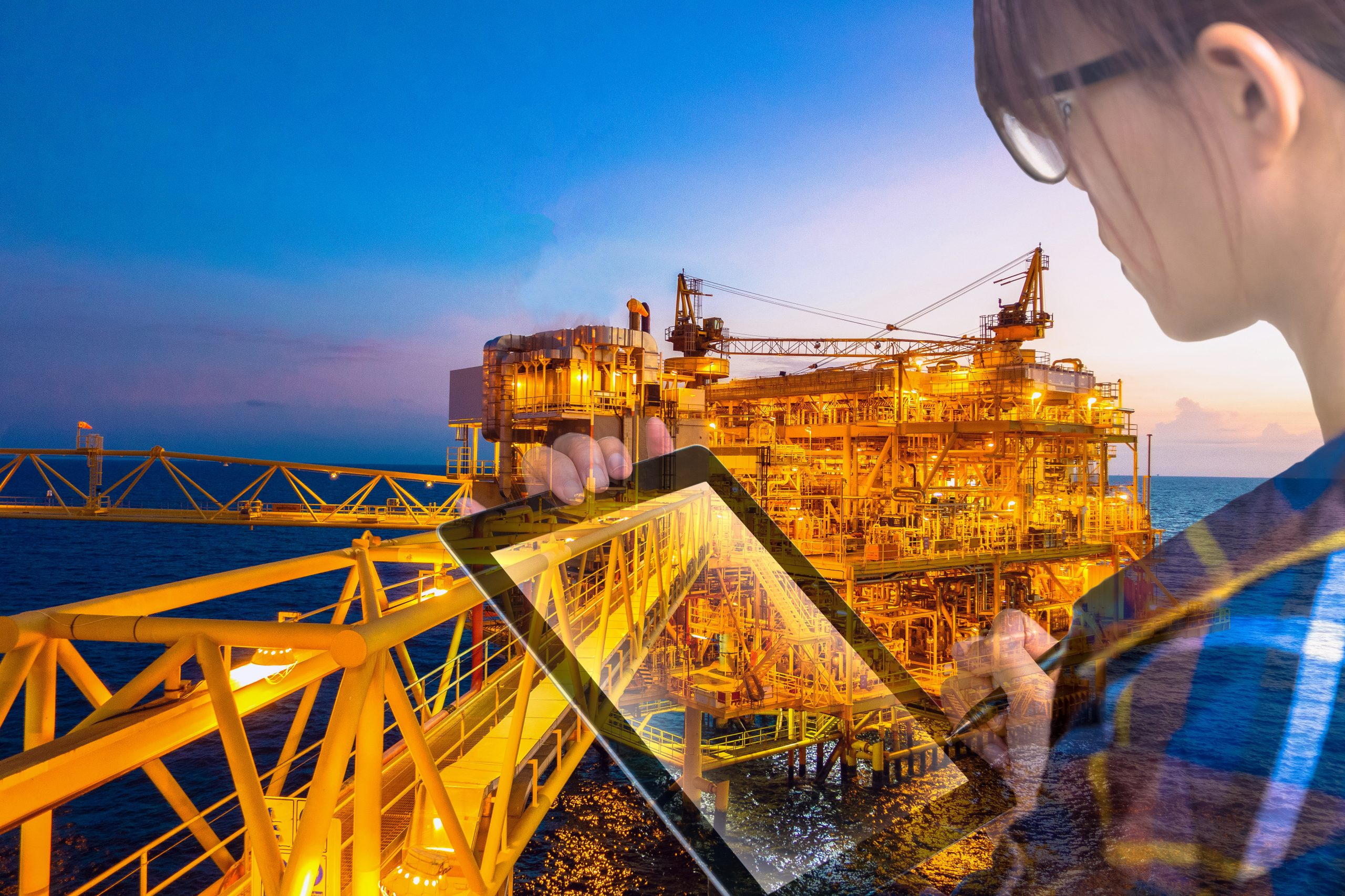 Double exposure of businesswoman in hipster shirt and wearing glasses working with tablet and oil and gas refinery industry