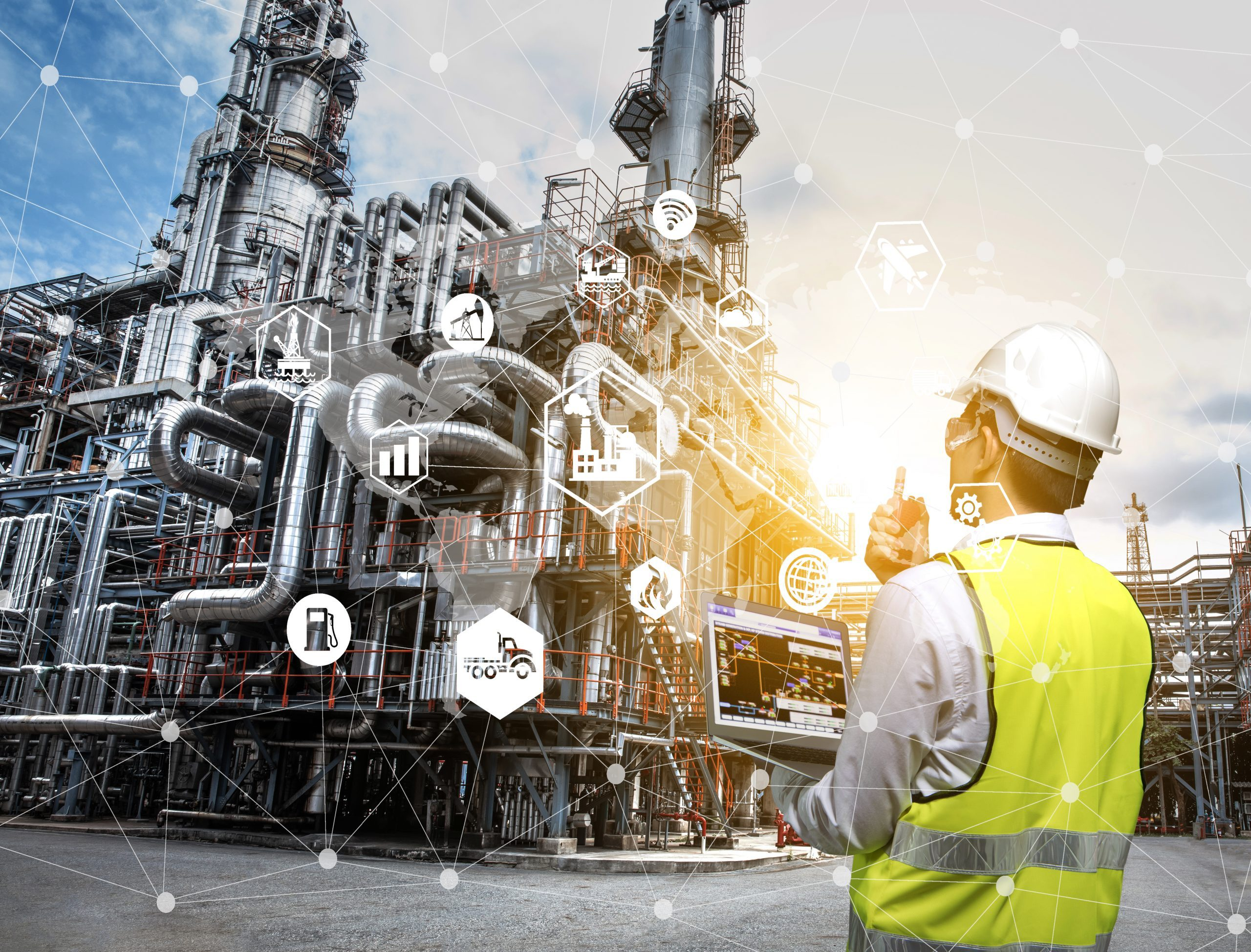 Double exposure of engineer holding walkie talkie are working orders the oil and gas refinery plant. Industry petrochemical concept image and icon connecting networking using technology.